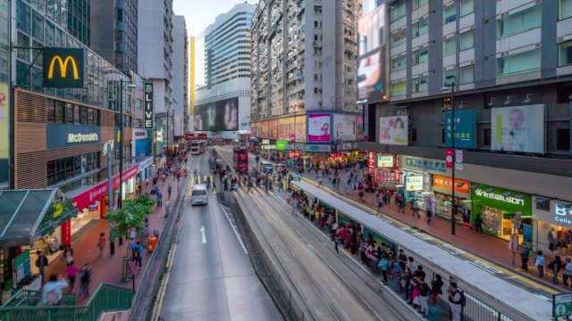 time-lapse: pedestrians tourist with historic  tram in background at causeway bay  hong kong - traffic time lapse stock videos & royalty-free footage