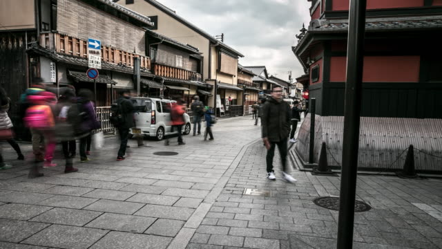 time-lapse: pedestrians tourists shopping gion district in kyoto, japan - gion stock videos and b-roll footage