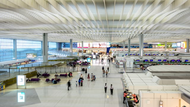 hd time-lapse: pedestrians travel at large building environment hong kong - hong kong international airport stock videos and b-roll footage