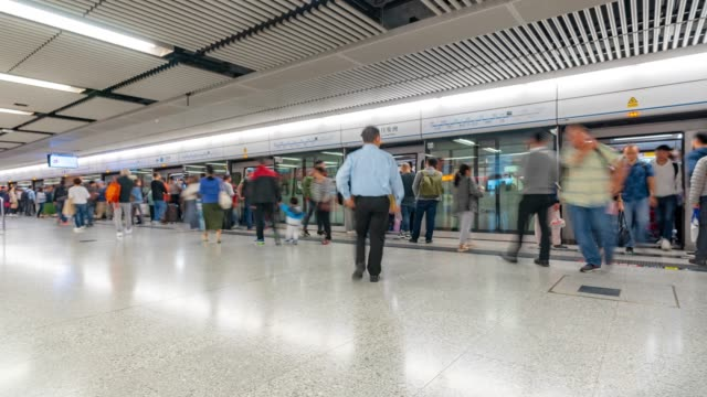 time-lapse: pedestrians traveler and tourist crowd in subway metro train station in hong kong - underground train stock videos & royalty-free footage
