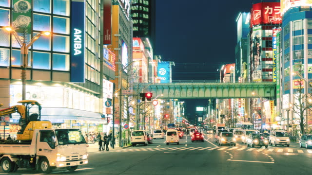 time-lapse: pedestrians walking at akihabara district tokyo japan, time lapse panning to right - akihabara stock videos and b-roll footage