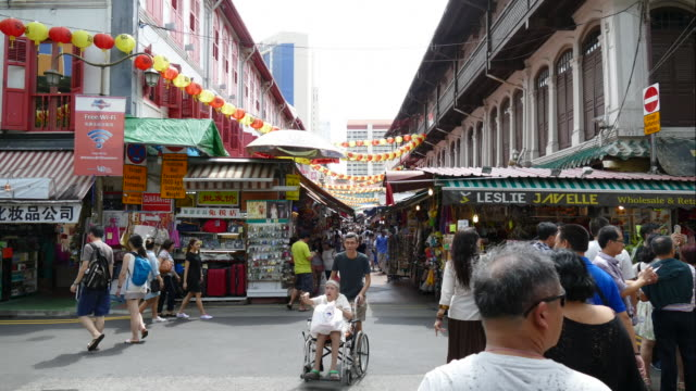 time-lapse people at chinatown centre in Singapore
