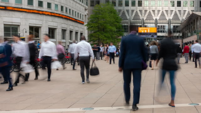 time-lapse people businessman crowd at canary wharf downtown in london england uk - pavement stock videos & royalty-free footage