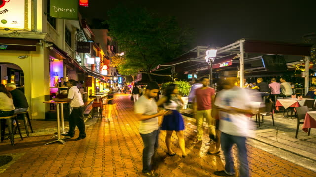 4K Time-lapse: People crowd at Boat Quay street at night