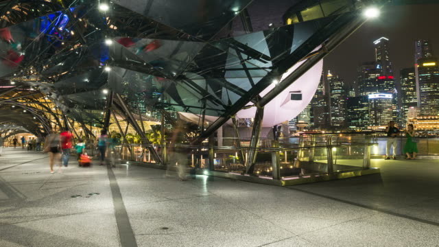 hd time-lapse: people crowd at the helix bridge in singapore night - helix bridge stock videos & royalty-free footage