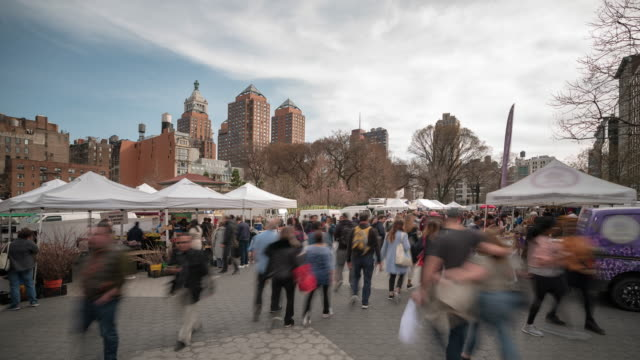 time-lapse: people crowded at union square greenmarket park flea market at broadway new york city usa - town square stock videos & royalty-free footage