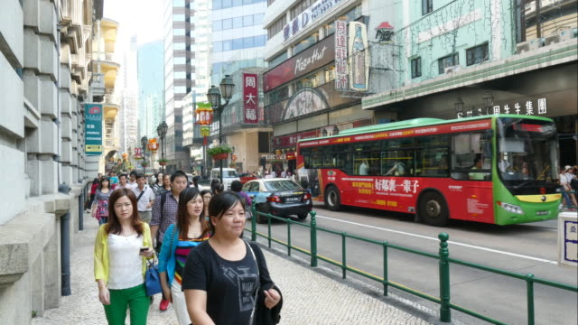 time-lapse people crowded in macau - leal senado square stock videos and b-roll footage