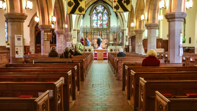 Timelapse people fill pews at church for Easter service, UK