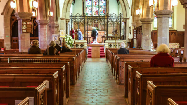 timelapse people fill pews at church for easter service, uk - religious celebration stock videos & royalty-free footage