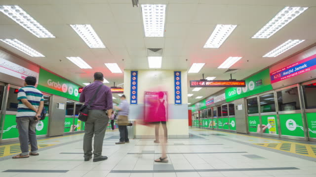 4K Timelapse: People in a subway station