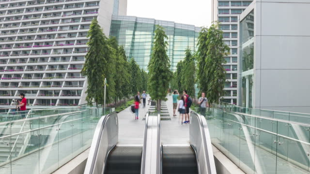 hd time-lapse: people moving on escalator in shopping mall. - marina bay sands stock videos and b-roll footage