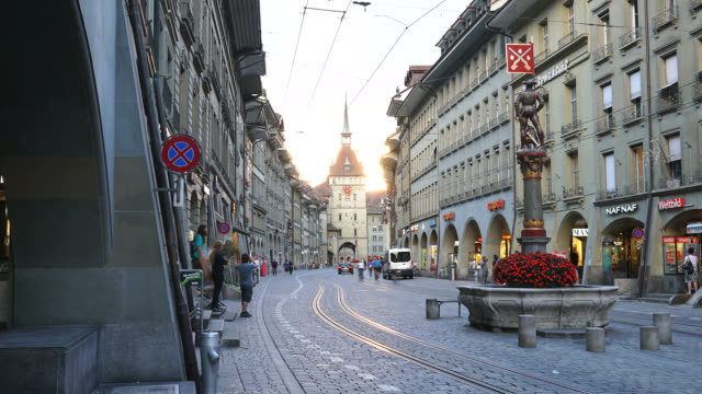 Timelapse People on the shopping alley with clock tower in Bern, Swiss