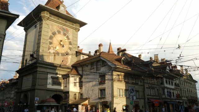 Timelapse People on the shopping alley with the Zytglogge astronomical clock tower of Bern in Switzerland.