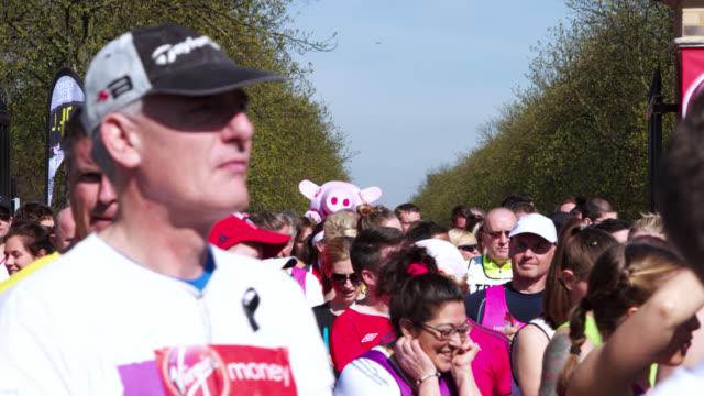 timelapse people run past during london marathon, uk - london marathon stock videos & royalty-free footage
