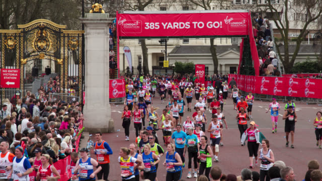 timelapse people stream around course during london marathon, uk - sports race stock videos and b-roll footage