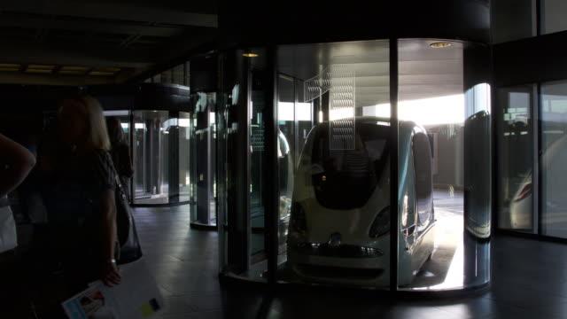 timelapse people using electric pod car dock, masdar, abu dhabi - alternative energy stock videos & royalty-free footage