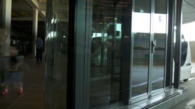 Timelapse people using electric pod car dock, Masdar, Abu Dhabi