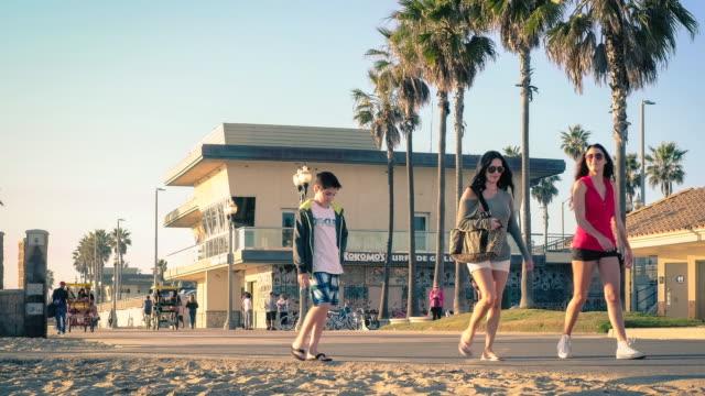 timelapse, people walk the huntington beach boardwalk - huntington beach california stock videos and b-roll footage
