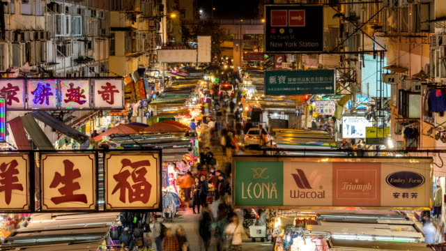 timelapse people walking in market in mong kok, hong kong at night - awning stock videos and b-roll footage