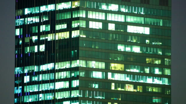 time-lapse People working in office, dusk to night