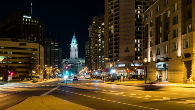 time-lapse: philadelphia city hall along benjamin franklin pkwy with city center skylines skyscraper building in downtown pa usa at night - center city philadelphia stock videos and b-roll footage