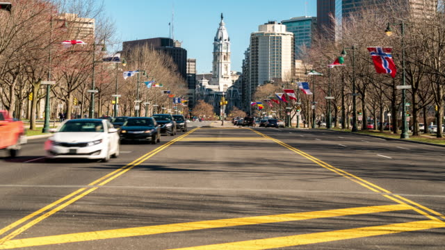 time-lapse: philadelphia city hall along benjamin franklin pkwy with skylines skyscraper building background in pa usa - logan circle stock videos and b-roll footage