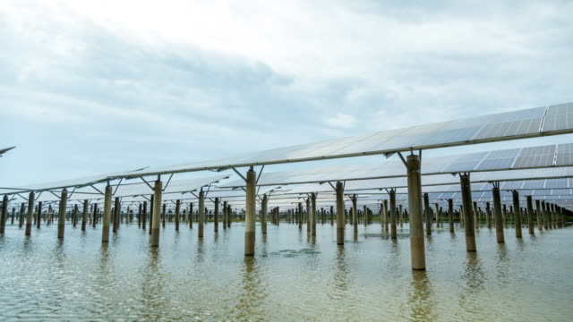 time-lapse photography of solar power plant - carbon footprint stock videos and b-roll footage