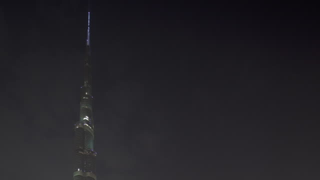 Timelapse pinnacle of Burj Khalifa skyscraper at night, Dubai