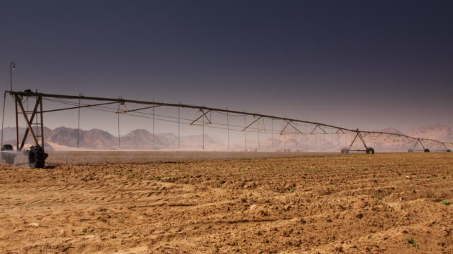 timelapse pivot irrigation system watering crops in desert, jordan - irrigation equipment stock videos & royalty-free footage