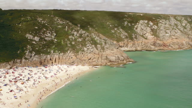 timelapse porthcurno beach  wide shot - lands end cornwall stock videos and b-roll footage