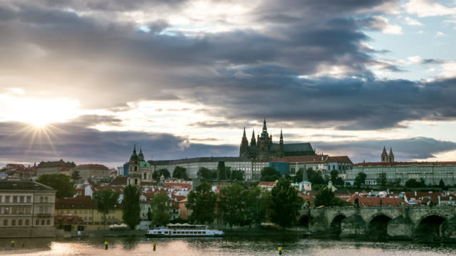 4k time-lapse: prague cityscape with vltava river czech republic - mala strana stock videos and b-roll footage