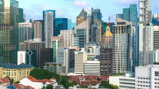 Timelapse Pull Back from 'The City' to the Buddha Tooth Relic Temple at Nightfall, Singapore