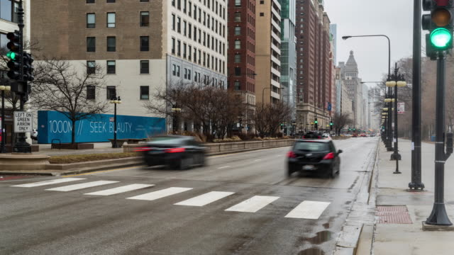 time-lapse: raining in chicago downtown from grant park, il usa - crosswalk sign stock videos & royalty-free footage