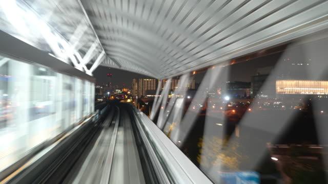 zeitraffer: reiten einschienenbahn in tokio japan - einschienenbahn stock-videos und b-roll-filmmaterial