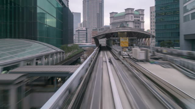 time-lapse: riding monorail in tokyo japan - railway station platform stock videos & royalty-free footage