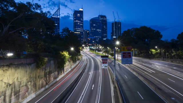 4k timelapse road to the city at night - motorway stock videos & royalty-free footage