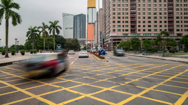 4k: time-lapse road transportation at macau china - macao flag stock videos and b-roll footage
