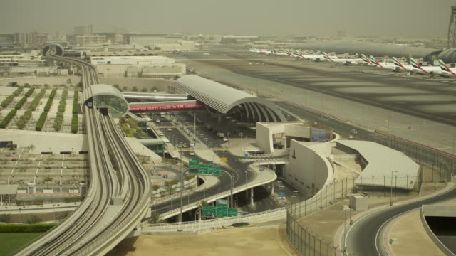 Timelapse roads, Metro, planes and airport terminal, Dubai
