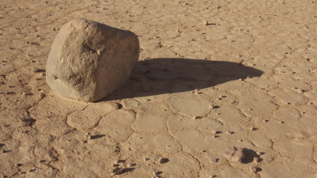 Timelapse rock shadow shifts in desert valley, Wadi Rum, Jordan