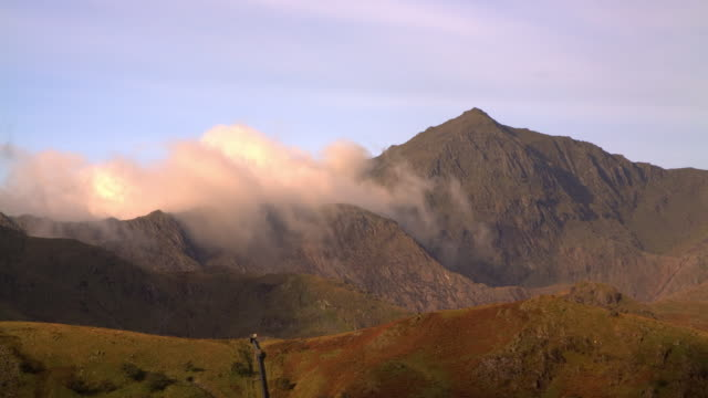 time-lapse rolling clouds over the summit of snowdon in the early morning - snowdonia stock videos & royalty-free footage