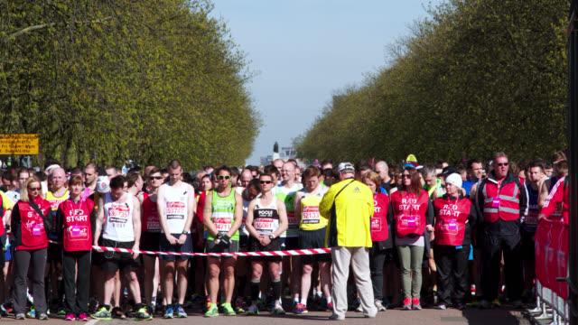 timelapse runners at start line of london marathon, uk - london marathon stock videos & royalty-free footage