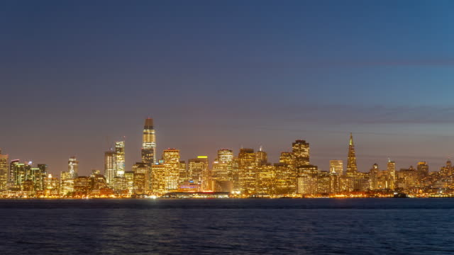 time-lapse san francisco downtown skyline at dusk from treasure island, california, sunset, usa - passenger craft stock videos & royalty-free footage