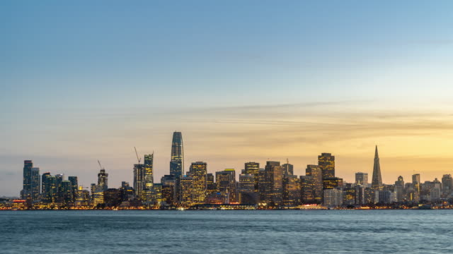 time-lapse san francisco downtown skyline at dusk from treasure island, california, sunset, usa - san francisco oakland bay bridge stock videos and b-roll footage
