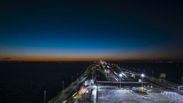 time-lapse : sea and highway dawn - tokyo bay stock videos & royalty-free footage