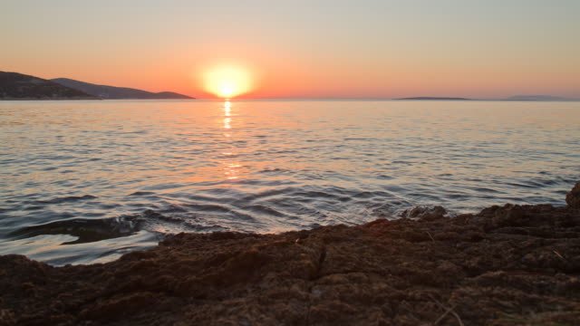 hd time-lapse: seascape at sunset to night - sunset to night stock videos & royalty-free footage