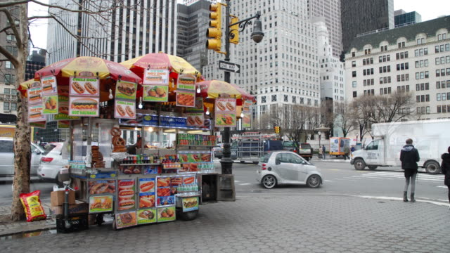 timelapse sequence - hot dog stand & pedestrians, central park south nyc - kiosk stock-videos und b-roll-filmmaterial