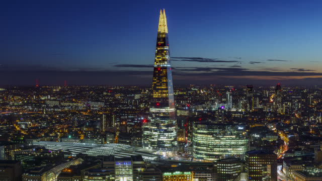 timelapse sequence of aerial view on london skyline with the shard and river thames at night - skyline stock videos & royalty-free footage
