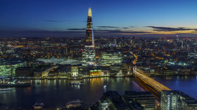 timelapse sequence of aerial view on london skyline with the shard and river thames at night shot on 7th january 2018 - shard london bridge stock videos & royalty-free footage