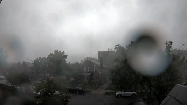 timelapse sequence of storm clouds and torrential rain from a thunderstorm on july 8, 2021 in the rego park neighborhood of queens, new york, new... - dramatic sky stock videos & royalty-free footage