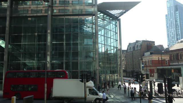 timelapse sequence outside the headquarters of the royal bank of scotland group plc in london showing pedestrians and traffic passing along in street... - plc stock videos & royalty-free footage